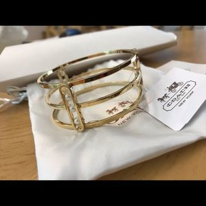 Coach gold bangle with pearls